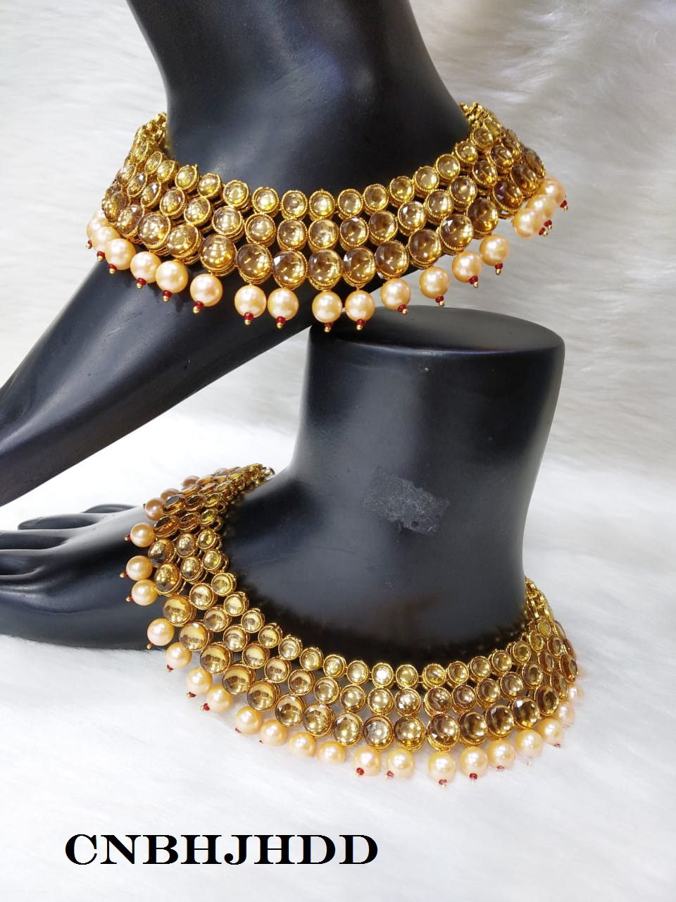 6ba5b1cce618de A mere look will be enough for you to fall in love with these pretty  anklets from CNB Exports. Beautifully designed, these anklets will go well  with any of ...